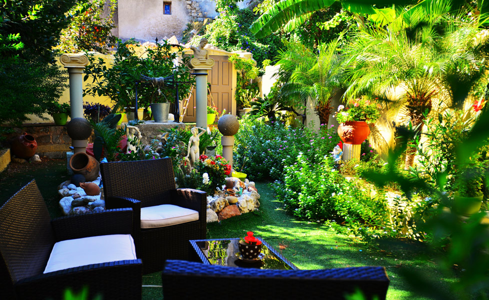 Hotel Olympos on Old town of Rhodes island is surrounded by a bright green garden